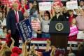 President Donald Trump praises Republican Marsha Blackburn during her Senate race in 2018. Photo: TNS