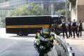 Ramanjit Singh arrives under heavy police escort at the High Court. Photo: Edmond So