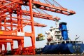 """An oceangoing freighter loads containers at a port in Lianyungang, in eastern Jiangsu province, on September 7. While the contribution of exports to China's growth formula has shrunk over the years, they are still expected to play an important role in the country's """"dual circulation"""" strategy. Photo: Xinhua"""