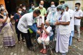 An elderly Indian woman leaves hospital in Guwahati after recovering from coronavirus. Photo: EPA
