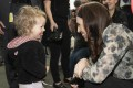 New Zealand Prime Minister Jacinda Ardern is greeted by a young child while campaigning in Christchurch. Photo: AP
