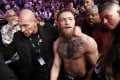 Conor McGregor is escorted from the Octagon after fighting Khabib Nurmagomedov in a lightweight title bout at UFC 229. Photo: AP