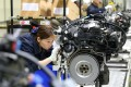Workers build car engines at a factory in Mianyang, Sichuan province. Photo: Reuters