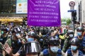 Police hold up a flag warning against breaches to the national security law in Causeway Bay on Thursday. Photo: Sam Tsang