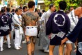 Yakuza gang members show their tattoos at a festival in Tokyo. In East Asia's conservative societies, body art is associated with criminals, despite its embrace by young people. Photo: Shutterstock
