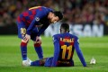 Barcelona's Lionel Messi talks to Ousmane Dembele as he is down injured in a Champions League game against Borussia Dortmund in 2019. Photo: Reuters