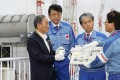 Yoshihide Suga, left, on his first official domestic visit to the disaster-stricken Fukushima Daiichi nuclear power plant last month. Photo: Kyodo