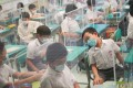 Students return to in-person classes at a primary school in Cheung Sha Wan on September 29. Nearly 900,000 pupils from all Hong Kong schools and kindergartens have returned to in-person classes for the first time in more than half a year amid the Covid-19 pandemic. Photo: Winson Wong