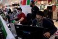 Writers and editors of ABS-CBN in the newsroom at their Manila headquarters following orders by the telecoms regulator to cease operations. Photo: Reuters