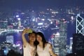 A couple takes a selfie at The Peak. Photo: SCMP / Felix Wong