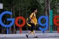 A man walks past Google's office in Beijing on August 8, 2018. Photo: Reuters