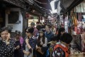 Visitors crowd onto a narrow alley in Zhujiajiao Water Town on the outskirts of Shanghai. Photo: Bloomberg