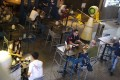 Customers drinking at a bar in Tsim Sha Tsui, following the coronavirus disease (COVID-19) outbreak. Photo: SCMP / Edmond So