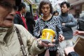 Consumers pick up free tubs of Hoi Tin Tong herbal jelly back in 2014. Photo: SCMP