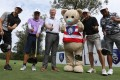 Hong Kong Golf Club general manager Ian Gardner (third left) poses with golfers and club mascot Fanling Freddie at the club's Open Day. Photo: May Tse