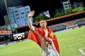 China's Brazilian-born forward Elkeson, known as Ai Kesen in Chinese, celebrates with a Chinese national flag after a Fifa World Cup Qatar qualifying win over Maldives. Photo: AFP