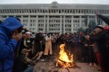 People protesting the results of a parliamentary vote gather by a bonfire in front of the seized main government building, known as the White House, in Bishkek, Kyrgyzstan, on October 6. Photo: AFP