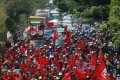 Workers in Bandung block a road during a strike against the newly enacted Omnibus Law. Photo: AFP