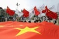 Residents hold Chinese and Olympics flags at a rehearsal for a celebration event in Zhangjiakou, which will join Beijing in hosting the 2022 Winter Olympic Games. Photo: Reuters