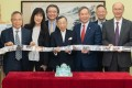 Hong Kong 'godfather of journalism' Raymond Roy Wong (centre) attends a signing ceremony for a HK$50 million donation to Baptist University on Wednesday. Photo: Facebook