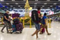 Tourists walk through Bangkok's Suvarnabhumi airport before Covid-19 put a freeze on most international travel. Photo: AFP