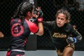 Denice Zamboanga throws a punch at Jihin Radzuan. Photos: ONE Championship