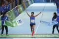 Christy Yiu Kit-ching wins the women's half marathon at the 2019 Standard Chartered Hong Kong Marathon, in Victoria Park, Causeway Bay. Photo: Nora Tam