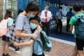A mother hugs her son goodbye on the first day back to school after four-month coronavirus closures, in Tai Kok Tsui on May 20. Photo: Nora Tam