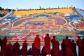 """The """"sunning of the Buddha"""" ceremony is held at the Drepung Monastery in Lhasa in August. A senior official said there would be an """"orderly"""" opening up in Tibet. Photo: Xinhua"""