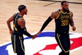 Los Angeles Lakers guard Kentavious Caldwell-Pope celebrates with forward LeBron James after making a three pointe against the Miami Heat in game five of the 2020 NBA Finals. Photo: USA Today Sports