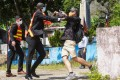 A scuffle erupts between a Taiwanese supporter and a security guard at Sun Yat-sen Garden in Tuen Mun on Saturday. Photo: Winson Wong