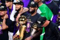 LeBron James of the Los Angeles Lakers with his MVP trophy and Finals trophy after winning the 2020 NBA Championship over the Miami Heat at the AdventHealth Arena in Lake Buena Vista, Florida. Photo: AFP