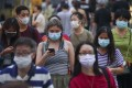 People crowd the streets in Mong Kok as the social-distancing rules against coronavirus relax. Photo: SCMP
