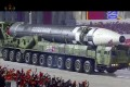 A military parade with what appears to be possible new ICBM missile. Photo: KRT via AP