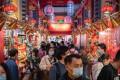 Shoppers browsing in souvenir shops crowd a path in Beijing on October 4. A significant rebound in domestic travel over the Golden Week holiday is fuelling optimism that consumers are starting to spend again after the pandemic-induced slump. Photo: Bloomberg