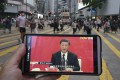 A man in Hong Kong watches a live broadcast of Chinese President Xi Jinping in Shenzhen. Photo: Felix Wong