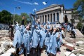 A group of Chinese graduates throw their hats into the sky after a commencement ceremony at Columbia University in New York, the United States on May 18, 2016. Photo: Xinhua