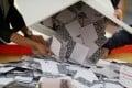 Officials open a ballot box at a polling station in Kowloon Tong, Hong Kong, on November 24, 2019. Photo: Reuters