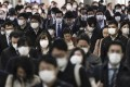 Commuters are seen walking to their offices in Tokyo. About 71 per cent of Japanese firms said women accounted for less than a tenth of management, while 17 per cent had no female managers at all. Photo: EPA-EFE