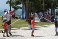 Children play at sword fighting at the West Kowloon Promenade on October 3, during the long National Day and Mid-Autumn Festival weekend. For Hong Kong pre-teens in a recent survey, two of the three lowest scores were for use of leisure time and being listened to by adults. Photo: Edmond So