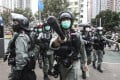 Riot police disperse protesters and media in the Tai Po area of Hong Kong in March. Photo: Dickson Lee