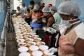 Residents of a slum prepare food to distribute to homeless people in the Copacabana neighbourhood, during a coronavirus disease outbreak in Rio de Janeiro, Brazil, on April 11. Photo: Reuters
