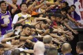 Fans in Shenzhen reach out to players after the NBA preseason game between the LA Lakers and Brooklyn Nets in the Guangdong on October 12, 2019. Photo: AFP