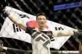 Jung Chan-sung celebrates after defeating Dennis Bermudez in their featherweight bout during the UFC Fight Night event at the Toyota Center on February 4, 2017 in Houston, Texas. Photo: AFP