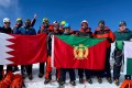An 18-member party of the Bahrain Royal Guard mountaineering team pose for photographs on Mount Lobuche East, a 6,119-metre Himalayan peak in Nepal they scaled in training for a successful ascent of 8,163-metre Mount Manaslu, the world's eighth highest peak. Photo: AFP/Tashi Lakpa Sherpa/Seven Summit Treks