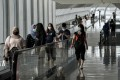 Visitors walk through Singapore's Changi Airport earlier this month. Interest in travel between Hong Kong and the city state is soaring. Photo: AFP