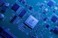 Integrated circuits, a collection of electronic components built onto a single piece of semiconducting material, are the backbone of almost all electronic devices. Photo: Reuters