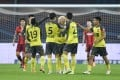 Wei Shihao (centre) celebrates his goal with Guangzhou Evergrande teammates in the Chinese Super League match against Hebei China Fortune. Photo: Xinhua