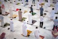 Muslims maintaining social distancing pray in the Grand Mosque on Sunday for the first time in months since the coronavirus restrictions were imposed. Photo: Saudi Press Agency handout via Reuters