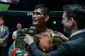 Aung La N Sang speaks to Mitch Chilson after defending his ONE light heavyweight title against Brandon Vera in Tokyo. Photos: ONE Championship